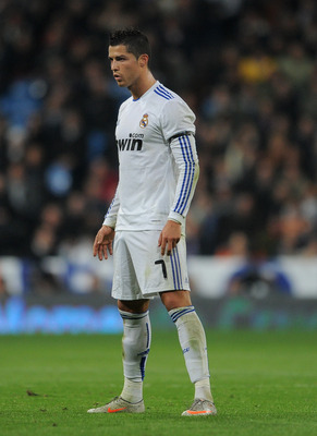 MADRID, SPAIN - JANUARY 13:  Cristiano Ronaldo of Real Madrid lines up a free kick during the quarter-final Copa del Rey first leg match between Real Madrid and Atletico Madrid at Estadio Santiago Bernabeu on January 13, 2011 in Madrid, Spain.  (Photo by