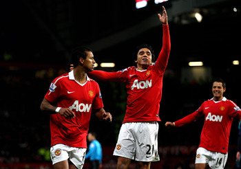 MANCHESTER, ENGLAND - JANUARY 04:  Nani (L) of Manchester United celebrates scoring his team's second goal with team mate Rafael during the Barclays Premier League match between Manchester United and Stoke City at Old Trafford on January 4, 2011 in Manche