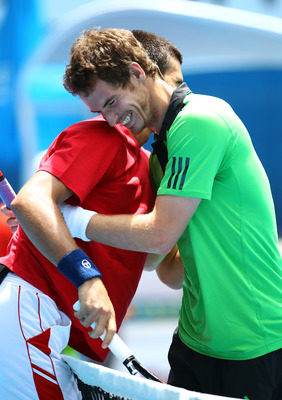 MELBOURNE, AUSTRALIA - JANUARY 16: Novak Djokovic of Serbia and Andy Murray of the United States hug at the net during the 'Rally For Relief' charity exhibition match ahead of the 2011 Australian Open at Melbourne Park on January 16, 2011 in Melbourne, Au