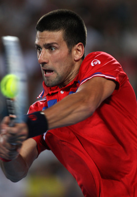 PERTH, AUSTRALIA - JANUARY 06:  Novak Djokovic of Serbia plays a return shot during his singles match against Ruben Bemelmans of Belgium on day six of the Hopman Cup at The Burswood Dome on January 6, 2011 in Perth, Australia.  (Photo by Paul Kane/Getty I