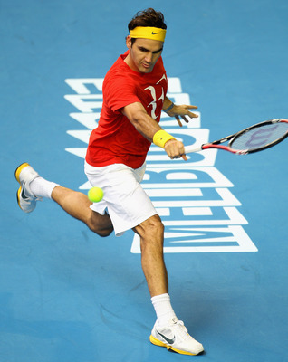 MELBOURNE, AUSTRALIA - JANUARY 12:  Roger Federer of Switzerland hits a backhand during a practice session ahead of the 2011 Australian Open at Melbourne Park on January 12, 2011 in Melbourne, Australia.  (Photo by Mark Dadswell/Getty Images)