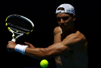 MELBOURNE, AUSTRALIA - JANUARY 15:  Rafael Nadal of Spain plays a backhand during a practice session ahead of the 2011 Australian Open at Melbourne Park on January 15, 2011 in Melbourne, Australia.  (Photo by Julian Finney/Getty Images)