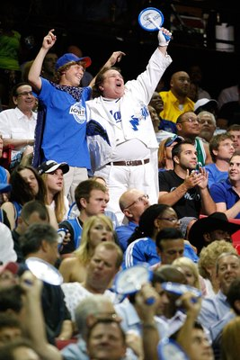 ORLANDO, FL - MAY 26:  Fans of the Orlando Magic support their team against the Boston Celtics in Game Five of the Eastern Conference Finals during the 2010 NBA Playoffs at Amway Arena on May 26, 2010 in Orlando, Florida.  NOTE TO USER: User expressly ack