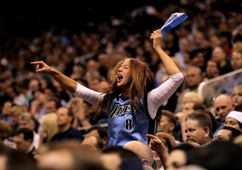 SALT LAKE CITY - APRIL 30:  A Utah Jazz fan cheers for her team during their game against the Denver Nuggets in Game Six of the Western Conference Quarterfinals of the 2010 NBA Playoffs at EnergySolutions Arena on April 30, 2010 in Salt Lake City, Utah. N