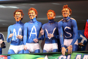 DALLAS - NOVEMBER 27: Dallas Mavericks fans cheer on their team against the Miami Heat on November 27, 2010 at the American Airlines Center in Dallas, Texas. NOTE TO USER: User expressly acknowledges and agrees that, by downloading and or using this Photo