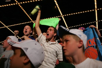 NEW YORK - JUNE 28: New York Knicks fans celebrate the Knicks' 23rd pick of Wilson Chandler of DePaul during the 2007 NBA Draft at the WaMu Theatre at Madison Square Garden June 28, 2007 in New York City. NOTE TO USER: User expressly acknowledges and agre