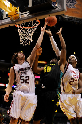 LOS ANGELES, CA - MARCH 11:  Forwards Caleb Forrest #52  and DeAngelo Casto #23 of the Washington State Cougars fight for the ball with forward Joevan Catron #50 of the Oregon Ducks during the Pacific Life Pac-10 Men's Basketball Tournament at the Staples