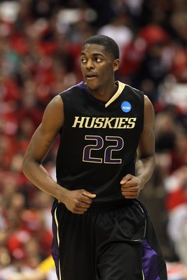 SYRACUSE, NY - MARCH 25:  Justin Holiday #22 of the Washington Huskies runs up court against the West Virginia Mountaineers during the east regional semifinal of the 2010 NCAA men's basketball tournament at the Carrier Dome on March 25, 2010 in Syracuse,