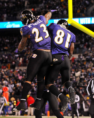 BALTIMORE, MD - DECEMBER 05:  Wide receiver Anquan Boldin #81 of the Baltimore Ravens celebrates his touchdown with teammate running back Willis McGahee #23 during the first quarter of the game against the Pittsburgh Steelers at M&T Bank Stadium on Decemb