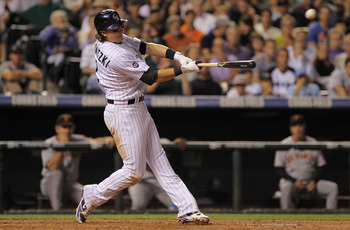 DENVER - SEPTEMBER 25:  Troy Tulowitzki #2 of the Colorado Rockies hits a two run homerun to give the Rockies a 5-4 lead over the San Francisco Giants in the fifth inning at Coors Field on September 25, 2010 in Denver, Colorado.  (Photo by Doug Pensinger/