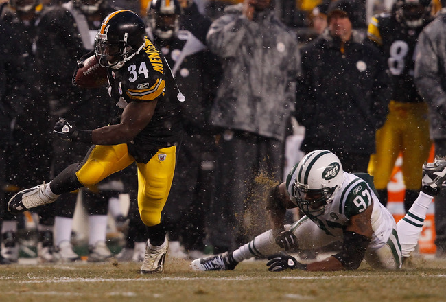PITTSBURGH - DECEMBER 19: Rashard Mendenhall #34 of the Pittsburgh Steelers runs by Calvin Pace #97 of the New York Jets during the game on December 19, 2010 at Heinz Field in Pittsburgh, Pennsylvania.  (Photo by Jared Wickerham/Getty Images)