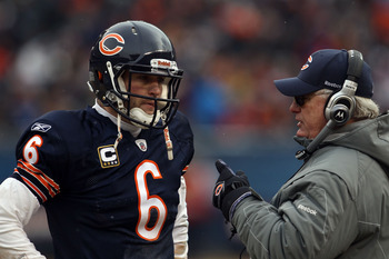 CHICAGO, IL - JANUARY 16:  Quarterback Jay Cutler #6 of the Chicago Bears talks with offensive coordinator Mike Martz in the second half against the Seattle Seahawks in the 2011 NFC divisional playoff game at Soldier Field on January 16, 2011 in Chicago,