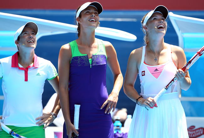 MELBOURNE, AUSTRALIA - JANUARY 16: (L-R) Justine Henin of Belgium, Ana Ivanovic of Serbia and Caroline Wozniacki of Denmark enjoy watching tennis during the 'Rally For Relief' charity exhibition match ahead of the 2011 Australian Open at Melbourne Park on