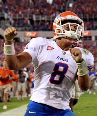 JACKSONVILLE, FL - OCTOBER 30:  Trey Burton #8 of the Florida Gators celebrates following a touchdown during the game against the Georgia Bulldogs at EverBank Field on October 30, 2010 in Jacksonville, Florida.  (Photo by Sam Greenwood/Getty Images)