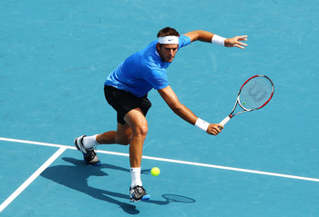 SYDNEY, AUSTRALIA - JANUARY 12:  Juan Martin Del Potro of Argentina plays a backhand in his match against Florian Mayer of Germany during day four of the 2011 Medibank International at Sydney Olympic Park Tennis Centre on January 12, 2011 in Sydney, Austr
