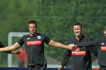 ST ALBANS, ENGLAND - AUGUST 31: Darren Bent, Matthew Upson, Gary Cahill and Wayne Rooney warm up during the England training session at London Colney on August 31, 2010 in St Albans, England.  (Photo by Michael Regan/Getty Images)