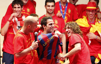 If Puyol really wants Cesc to come to Barcelona, maybe him and several of the players should chip in some of their wages to help increase their bid?