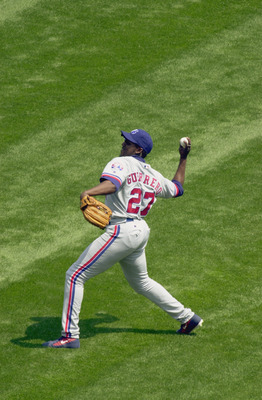 CHICAGO-JUNE 9:  Right fielder Vladimir Guerrero #27 of the Montreal Expos throws the ball back to the infield during the Interleague MLB game against the Chicago White Sox on June 9, 2002 at Comiskey Park in Chicago, Illinois. The White Sox won 13-2.  (P