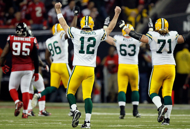 ATLANTA, GA - JANUARY 15:  Aaron Rodgers #12 of the Green Bay Packers reacts after he threw a 20-yard touchdown pass to James Jones #89 against the Atlanta Falcons during their 2011 NFC divisional playoff game at Georgia Dome on January 15, 2011 in Atlant