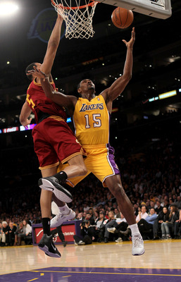 LOS ANGELES, CA - JANUARY 11:  Ron Artest #15 of the Los Angeles Lakers shoots over Ryan Hollins #5 the Cleveland Cavaliers at Staples Center on January 11, 2011 in Los Angeles, California.   NOTE TO USER: User expressly acknowledges and agrees that, by d