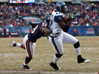 CHICAGO, IL - JANUARY 16:  Wide receiver Mike Williams #17 of the Seattle Seahawks catches a two-yard touchdown against Danieal Manning #38 of the Chicago Bears in the fourth quarter of the 2011 NFC divisional playoff game at Soldier Field on January 16,