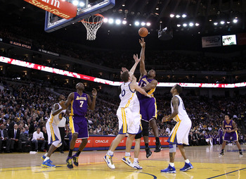 OAKLAND, CA - JANUARY 12:  Andrew Bynum #17 of the Los Angeles Lakers in action during their game against the Golden State Warriors at Oracle Arena on January 12, 2011 in Oakland, California. NOTE TO USER: User expressly acknowledges and agrees that, by d