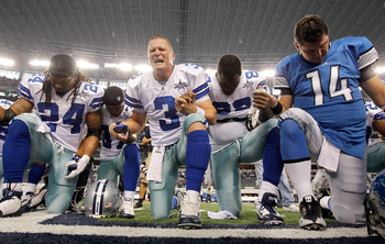 ARLINGTON, TX - NOVEMBER 21:  Quarterback Jon Kitna (C) #3 of the Dallas Cowboys leads a team prayer with running back Marion Barber #24, cornerback Bryan McCain #37, wide receiver Dez Bryant #88, and quarterback Shaun Hill #14 of the Detroit Lions at Cow
