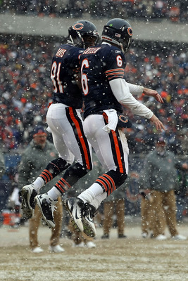 CHICAGO, IL - JANUARY 16:  Quarterback Jay Cutler #6 of the Chicago Bears celebrates his six-yard touchdown run with teammate Rashied Davis #81 against the Seattle Seahawks in the second quarter of the 2011 NFC divisional playoff game at Soldier Field on