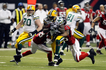 ATLANTA, GA - JANUARY 15:  James Starks #44 of the Green Bay Packers runs the ball against the Atlanta Falcons during their 2011 NFC divisional playoff game at Georgia Dome on January 15, 2011 in Atlanta, Georgia. The Packers won 48-21. (Photo by Kevin C.