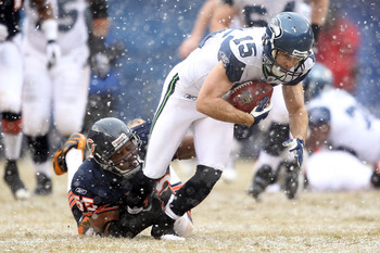 CHICAGO, IL - JANUARY 16:  Brandon Stokley #15 of the Seattle Seahawks attempts to run after a catch as Lance Briggs #55 of the Chicago Bears attempts to tackle him in the first half in the 2011 NFC divisional playoff game at Soldier Field on January 16,