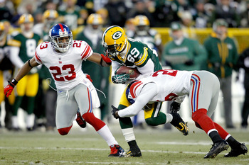 GREEN BAY, WI - DECEMBER 26:  James Jones #89 of the Green Bay Packers is tackled by Antrel Rolle #26 of the New York Giants at Lambeau Field on December 26, 2010 in Green Bay, Wisconsin.  (Photo by Matthew Stockman/Getty Images)