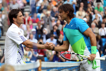 LONDON, ENGLAND - JUNE 09:  Rafael Nadal (R) of Spain shakes hands after victory in his second round match against Marcos Daniel of Brazilon Day 3 of the the AEGON Championships at Queen's Club on June 9, 2010 in London, England.  (Photo by Clive Brunskil