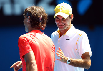 MELBOURNE, AUSTRALIA - JANUARY 16:  Rafael Nadal of Spain and Roger Federer enjoy the day during the 'Rally For Relief' charity exhibition match ahead of the 2011 Australian Open at Melbourne Park on January 16, 2011 in Melbourne, Australia.  (Photo by Ju