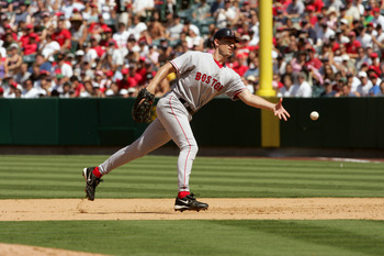 ANAHEIM, CA - AUGUST 21:  Infielder John Olerud #19 of the Boston Red Sox tosses the ball during the game against the Los Angeles Angels of Anaheim on August 21, 2005 at Angel Stadium in Anaheim, California.  The Red Sox won 5-1.   (Photo by Stephen Dunn/