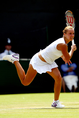 LONDON, ENGLAND - JUNE 23:  Karolina Sprem of Croatia in action during her second round match against Kim Clijsters of Belgium on Day Three of the Wimbledon Lawn Tennis Championships at the All England Lawn Tennis and Croquet Club on June 23, 2010 in Lond