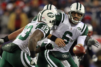 FOXBORO, MA - JANUARY 16:  Mark Sanchez #6 drops back with Shonn Greene #23 of the New York Jets during their 2011 AFC divisional playoff game against the New England Patriots at Gillette Stadium on January 16, 2011 in Foxboro, Massachusetts.  (Photo by A
