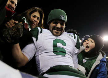 FOXBORO, MA - JANUARY 16:  Mark Sanchez #6 of the New York Jets celebrates with his mother Olga Macias after the Jets defeated the Patriots 28 to 21 in their 2011 AFC divisional playoff game at Gillette Stadium on January 16, 2011 in Foxboro, Massachusett