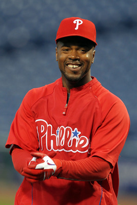 PHILADELPHIA - OCTOBER 23:  Jimmy Rollins #11 of the Philadelphia Phillies looks on during batting practice before Game Six of the NLCS during the 2010 MLB Playoffs at Citizens Bank Park on October 23, 2010 in Philadelphia, Pennsylvania.  (Photo by Al Bel