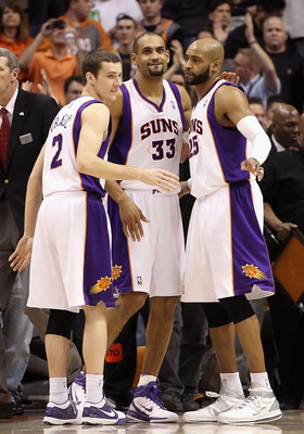 PHOENIX, AZ - JANUARY 14:  Goran Dragic #2, Grant Hill #33 and Vince Carter #25 of the Phoenix Suns celebrate after defeating the Portland Trail Blazers in the NBA game at US Airways Center on January 14, 2011 in Phoenix, Arizona. The Suns defeated the Tr
