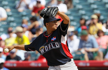 ANAHEIM, CA - JULY 11:  World Futures All-Star Hector Noesi #19 of the New York Yankees throws the ball during the 2010 XM All-Star Futures Game at Angel Stadium of Anaheim on July 11, 2010 in Anaheim, California.  (Photo by Stephen Dunn/Getty Images)