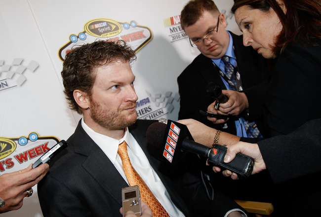LAS VEGAS, NV - DECEMBER 02:  Dale Earnhardt Jr. (C), driver of the #88 National Guard/AMP Energy Chevrolet, speaks to the media after the NASCAR Sprint Cup Series Champions Week NMPA Myers Brothers Awards Luncheon at the Bellagio on December 2, 2010 in L