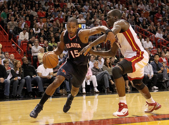 MIAMI, FL - DECEMBER 04:  Al Horford #15 of the Atlanta Hawks drives to the basket against Joel Anthony #50 of the Miami Heat during a game at American Airlines Arena on December 4, 2010 in Miami, Florida. NOTE TO USER: User expressly acknowledges and agr