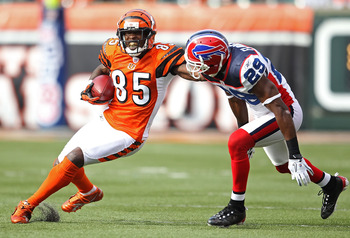 CINCINNATI - NOVEMBER 21:  Chad Ochocinco #85 of the Cincinnati Bengals runs with the ball while defended by Drayton Florence #29 of the Buffalo Bills during the NFL game  at Paul Brown Stadium on November 21, 2010 in Cincinnati, Ohio.  The Bills won 49-3
