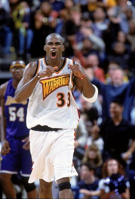 6 Dec 2000:  Antawn Jamison #33 of the Golden State Warriors celebrate as he runs down the court during the game against the Los Angeles Lakers at the Arena in Oakland, California. The Warriors defeated the Lakers 125-122. NOTE TO USER: It is expressly un