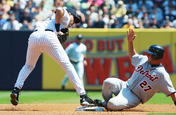 NEW YORK - AUGUST 19: Jhonny Peralta #27 of the Detroit Tigers slides safely into second base against Derek Jeter #2 of the New York Yankees in the second inning at Yankee Stadium on August 19, 2010 in the Bronx borough of New York City.  (Photo by Andrew