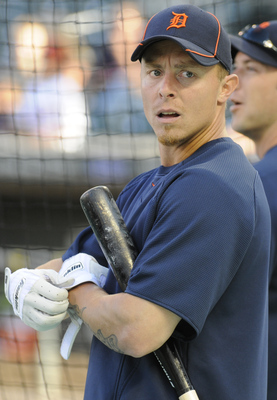 MINNEAPOLIS, MN - JUNE 28: Brandon Inge #15 of the Detroit Tigers reacts to Magglio Ordonez #30 walking off the field with a trainer during batting practice prior to their game against the Minnesota Twins on June 28, 2010 at Target Field in Minneapolis, M