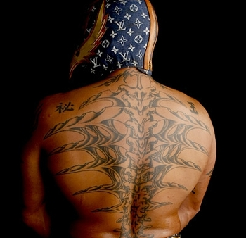 Ink in the ring top 10 best wrestlers tattoos bleacher for Rey mysterio tattoos