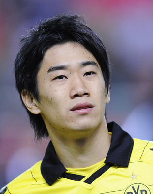 SEVILLE, SPAIN - DECEMBER 15:  Shinji Kagawa of Borussia Dortmund looks on prior the UEFA Europa League group J match between Sevilla and Borussia Dortmund at Estadio Ramon Sanchez Pizjuan on December 15, 2010 in Seville, Spain. The match ended 2-2.  (Pho