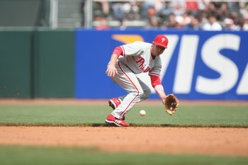SAN FRANCISCO - MAY 11:  Chase Utley #26 of the Philadelphia Phillies fields against the San Francisco Giants on May 11, 2008 at AT&T Park in San Francisco, California. (Photo by Jed Jacobsohn/Getty Images)