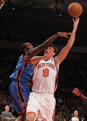 NEW YORK, NY - DECEMBER 22: Danilo Gallinari #8 of the New York Knicks is fouled by Serge Ibaka #9 of the Oklahoma City Thunder at Madison Square Garden on December 22, 2010 in New York City.   NOTE TO USER: User expressly acknowledges and agrees that, by